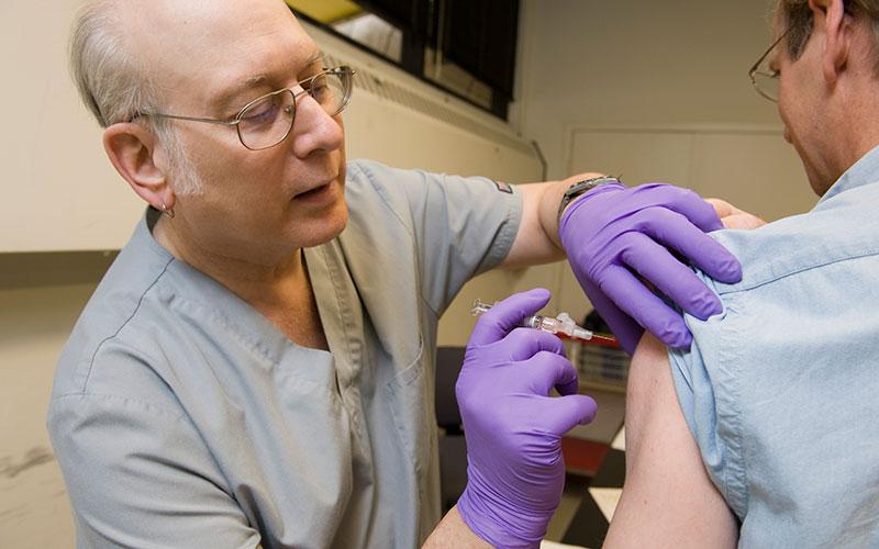 Nurse giving flu shot