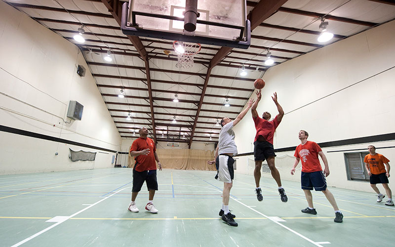 People playing basketball at the gym