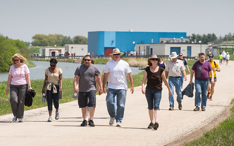 Employees walk around the Main Ring