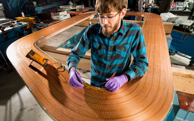 Steve Krave working on magnet coil
